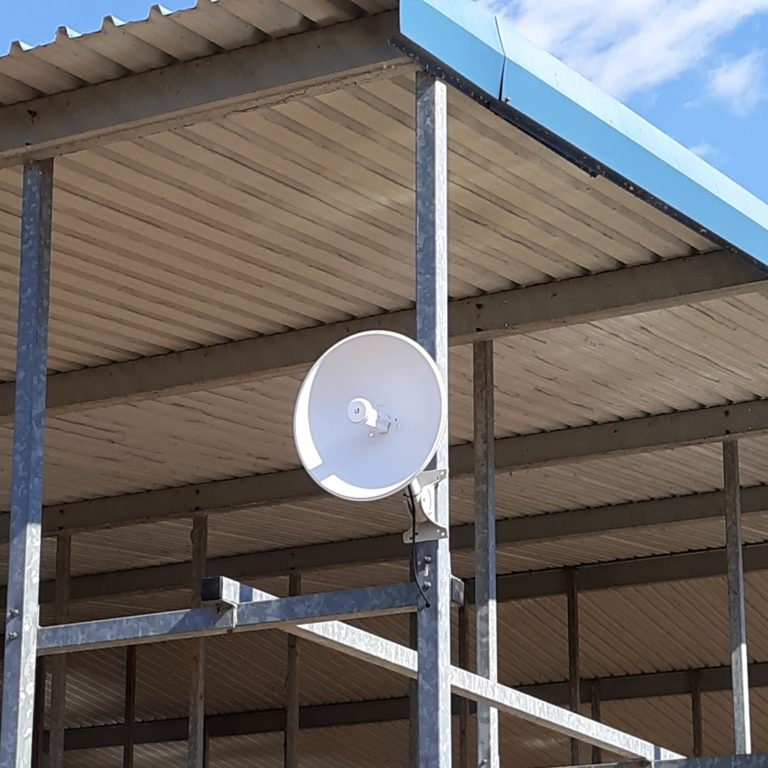 Ubiquiti radio mounted at a marina to send Wi-Fi to boat owners.